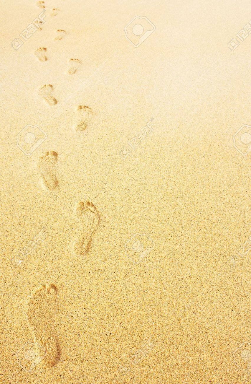 Footprints on the beach background great business concept for travelling - 15840772