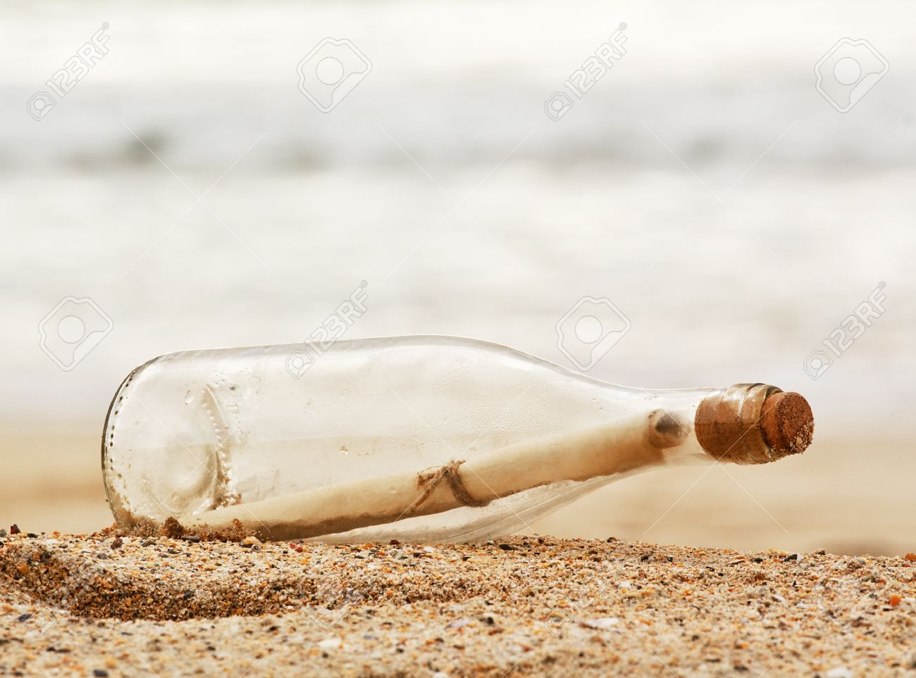 a Message in a bottle washed up on the beach, great business concept for snail mail, spam, or bad slow communication Stock Photo - 15840712