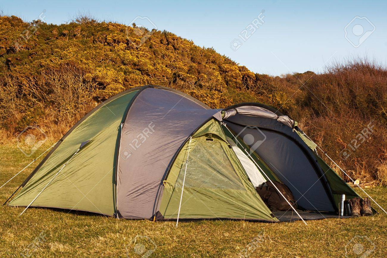dome tent pitched in field for wild c&ing in the great outdoors with front flap open & Dome Tent Pitched In Field For Wild Camping In The Great Outdoors ...