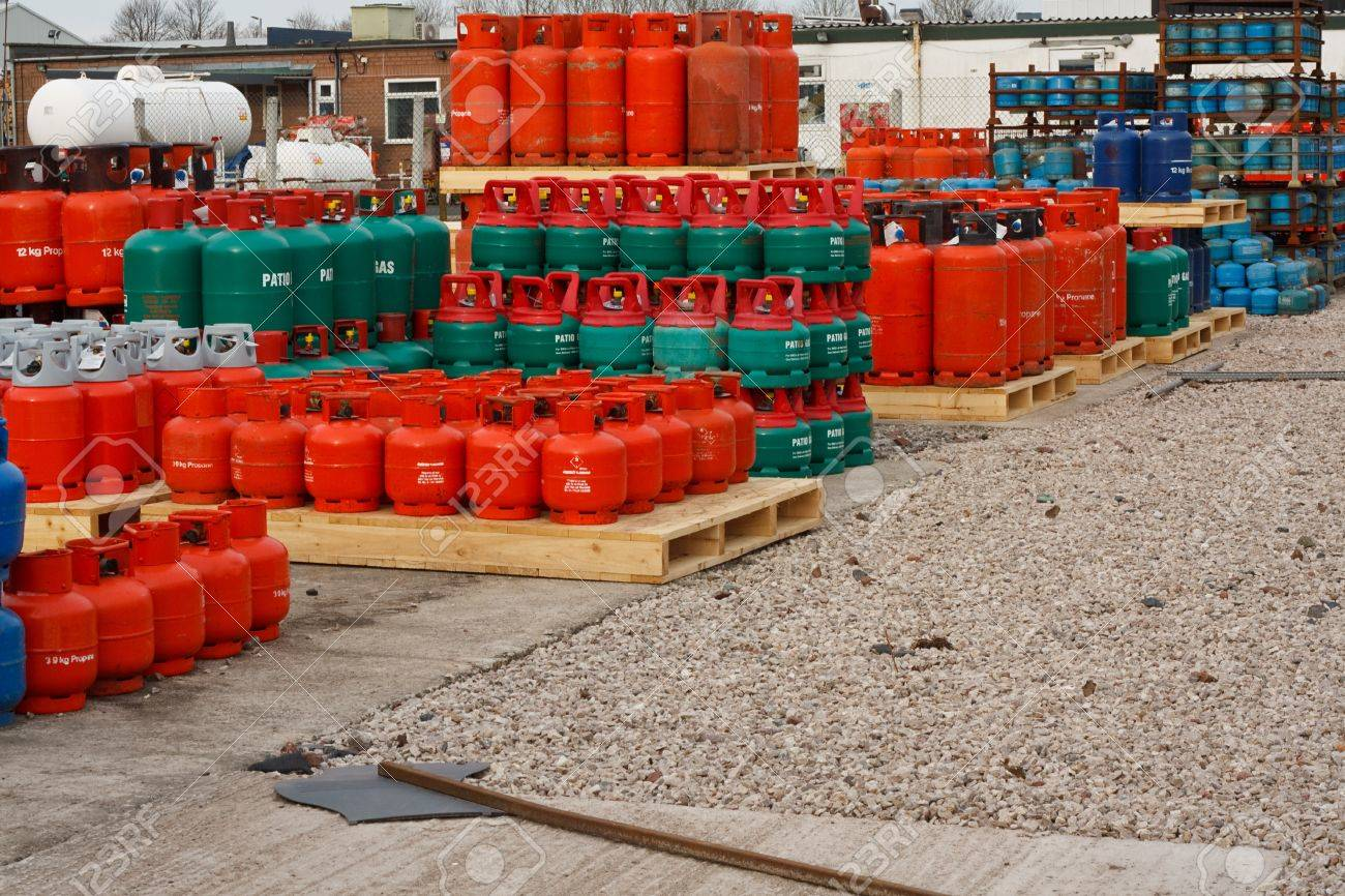Domestic propane gas bottles in storage at a distribution centre Stock Photo - 20446028