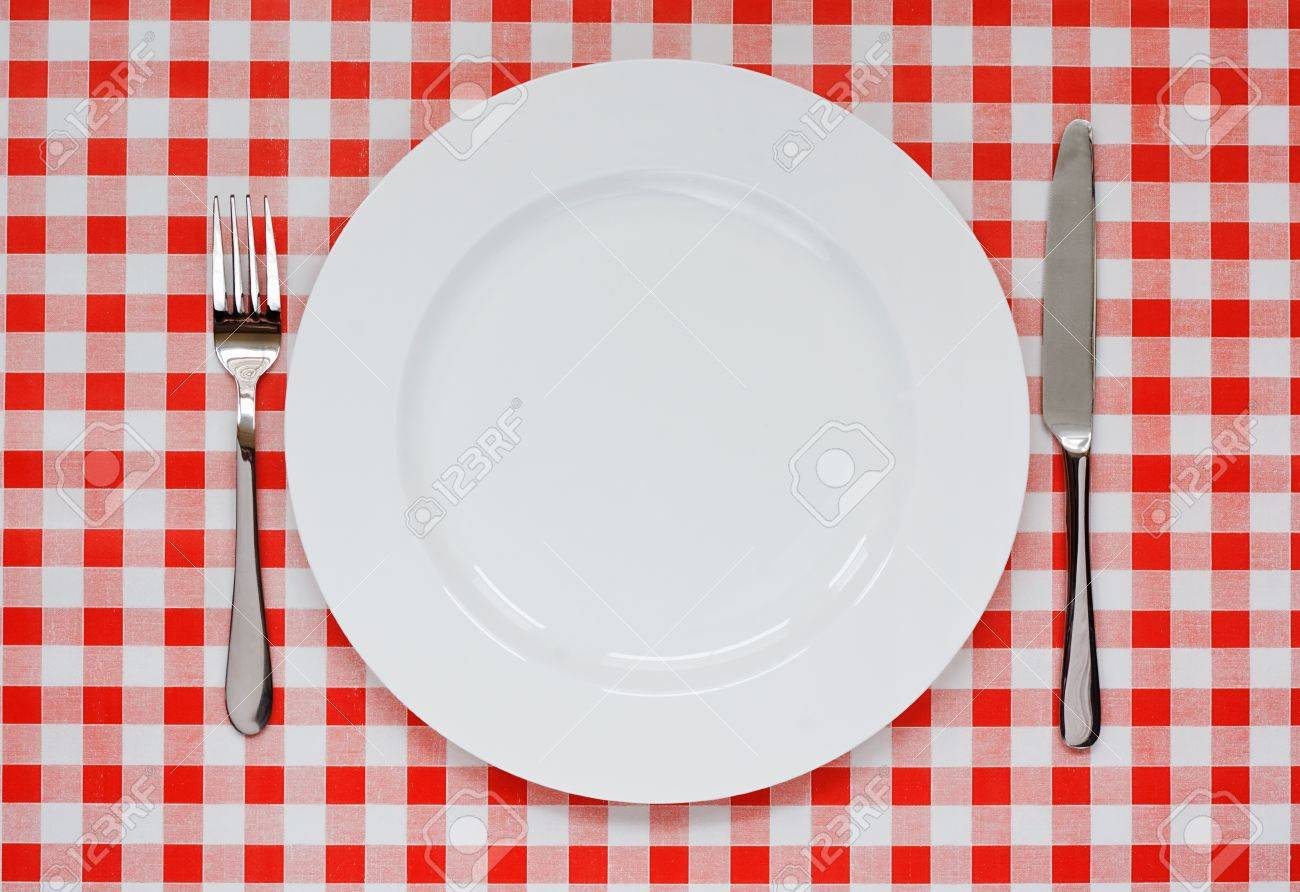 Empty Plate Setting With Plate, Knife And Fork On Red Gingham ...