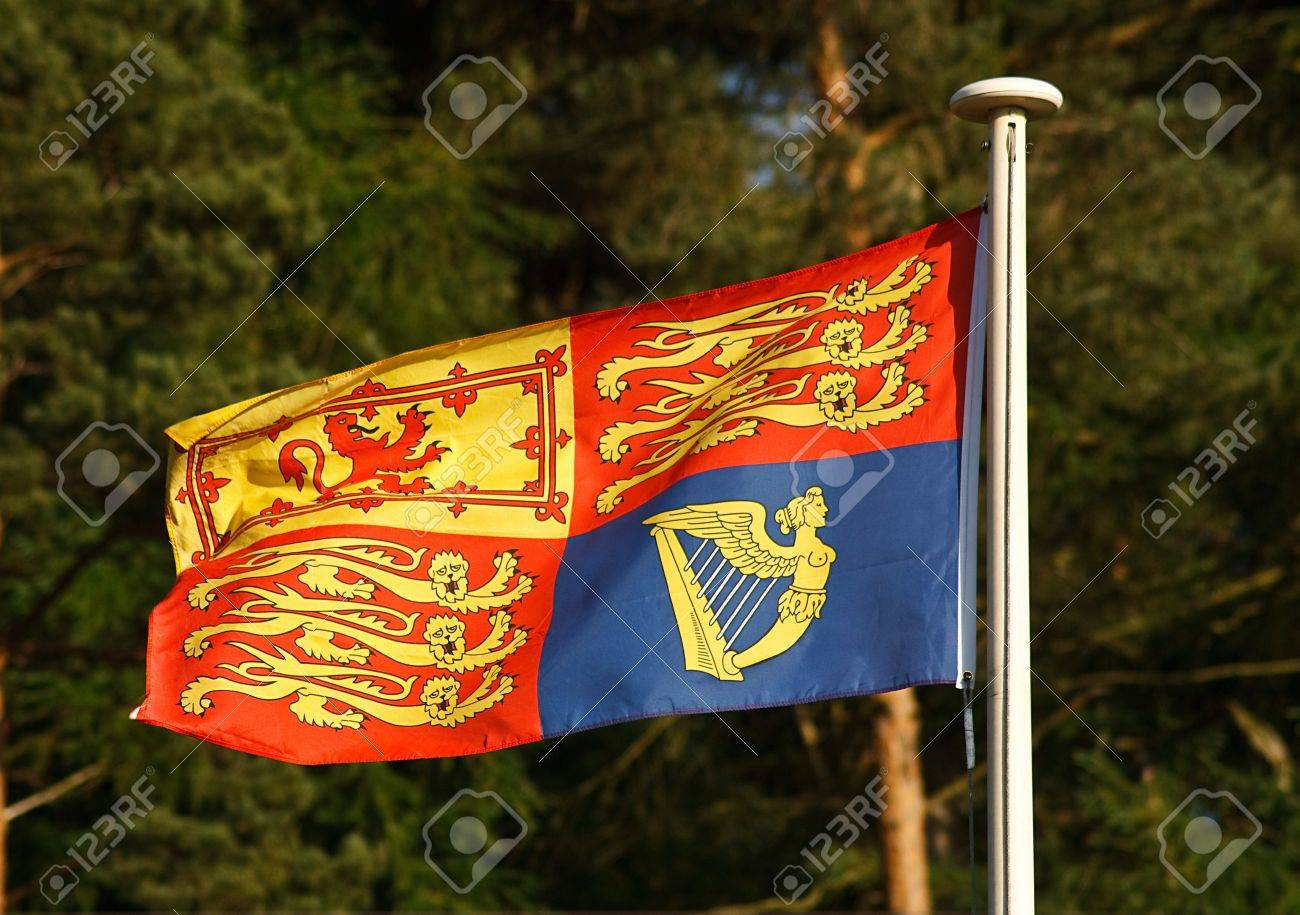 the traditional royal standard flag which is flown when the queen