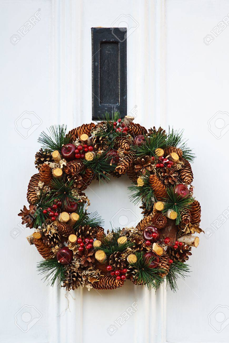 Festive Christmas Wreath On White Door At Xmas Stock Photo Picture