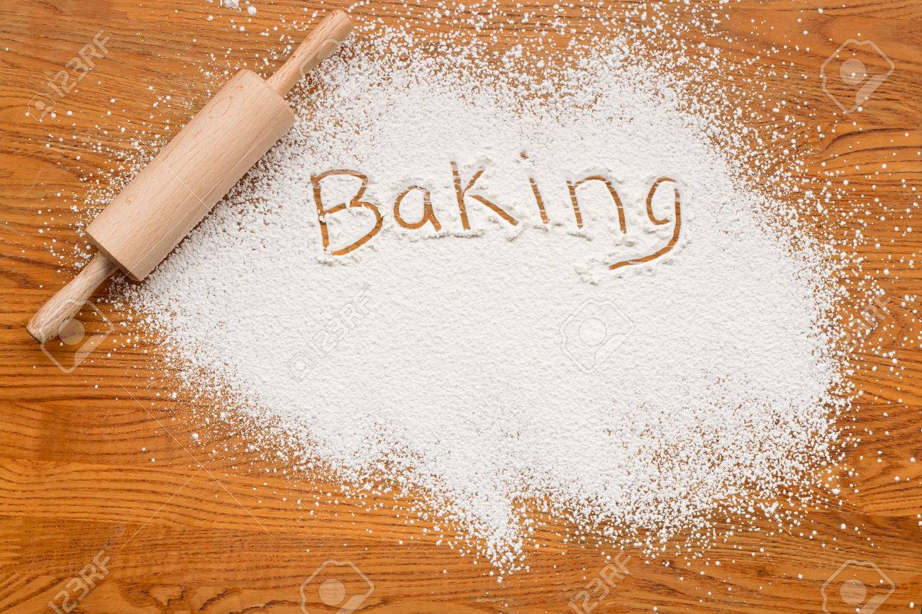 25251127-Flour-on-a-wooden-table-symbolising-a-Bakery-Baking-Notice-with-white-space-for-inclusion-of-text--Stock-Photo.jpg