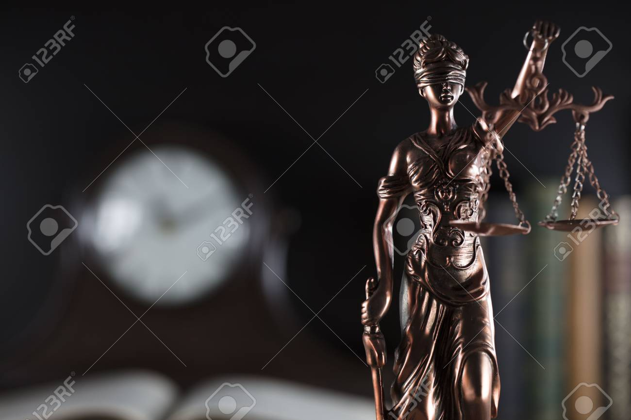Old court library. Vintage clock. Statue of justice - 87923597