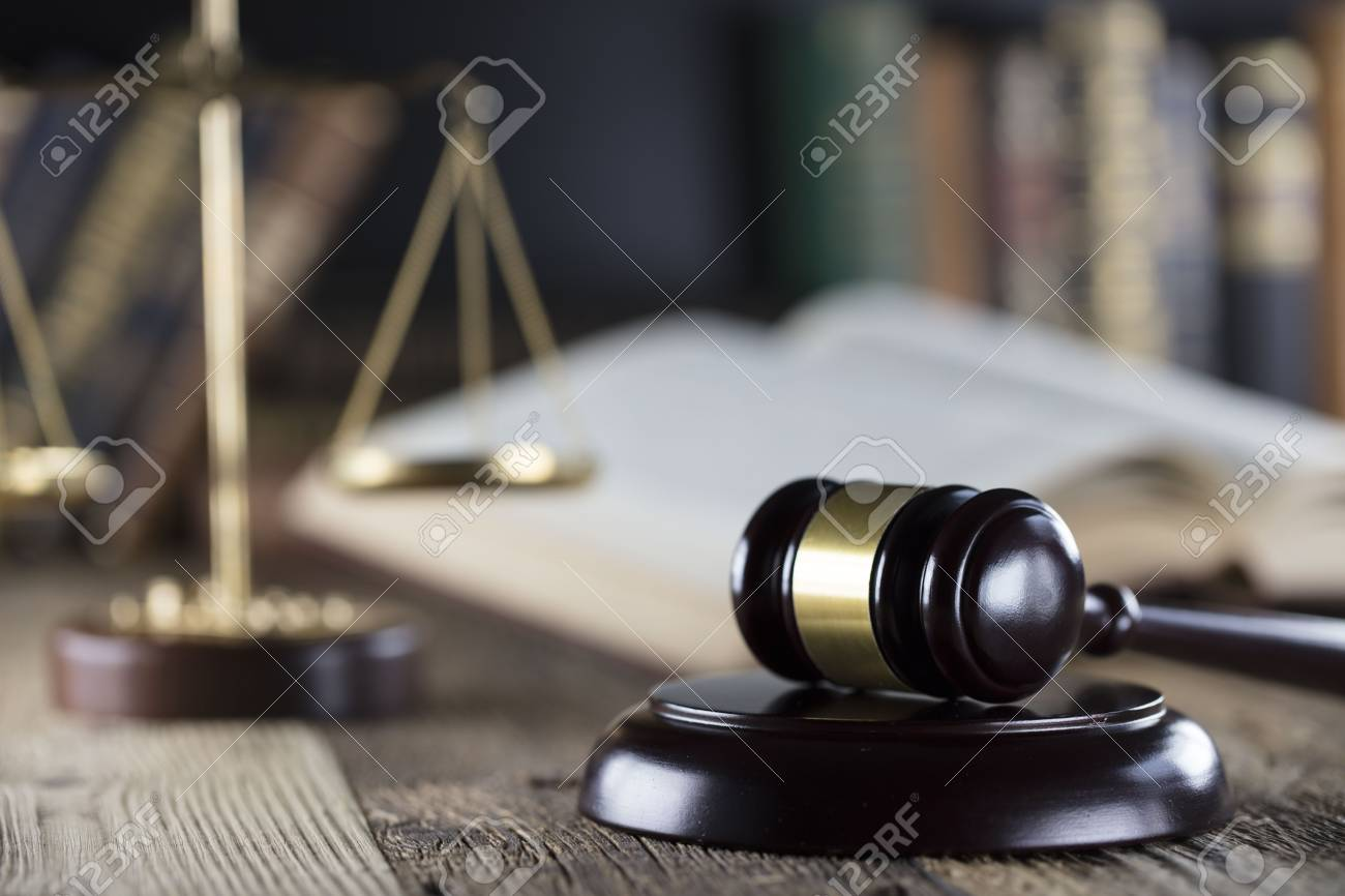 Judge concept. Mallet of the judge, justice scale and books on wooden desk. - 88862273