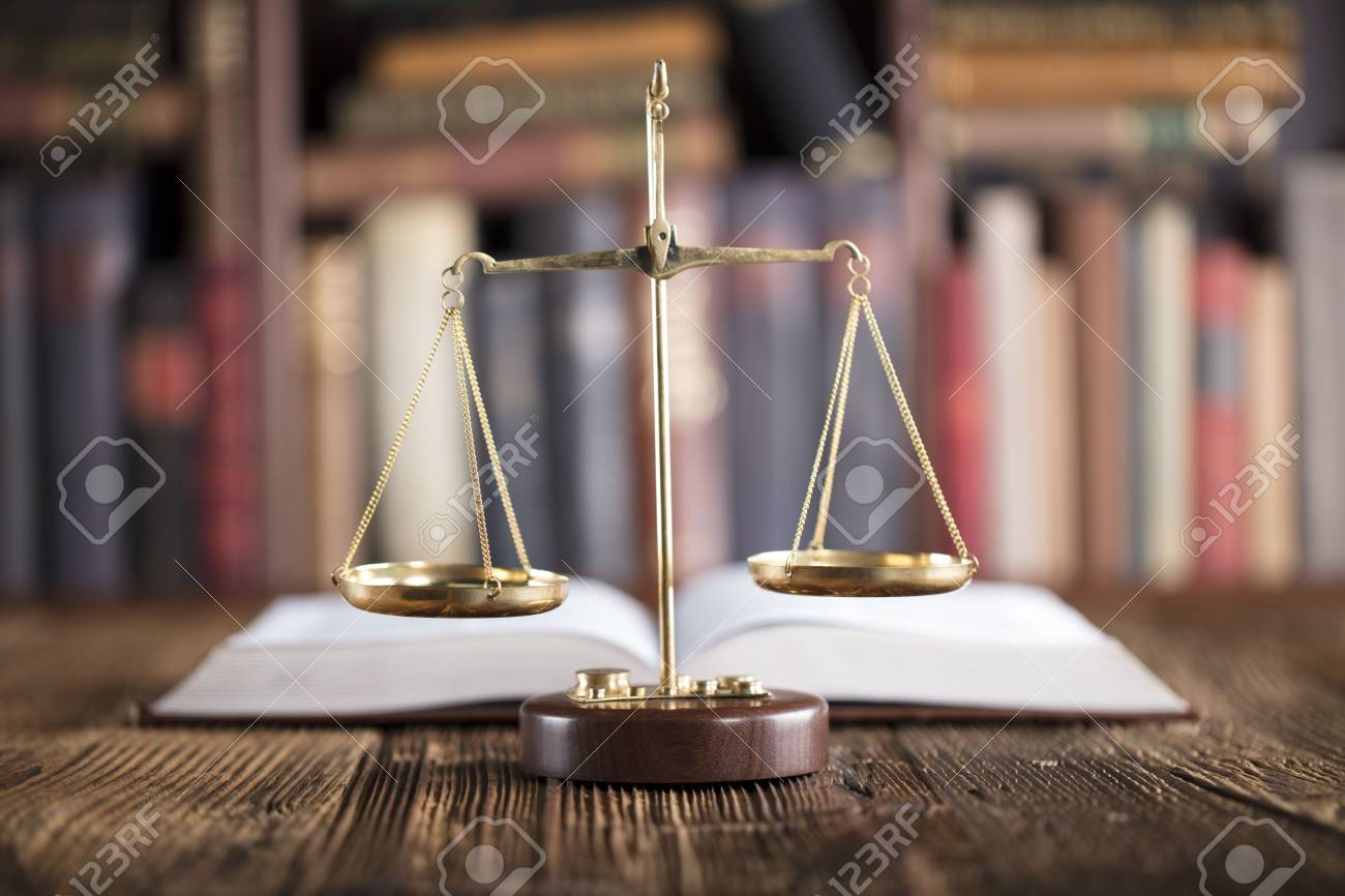 Legal office. Law firm. Scale and books. - 89485690