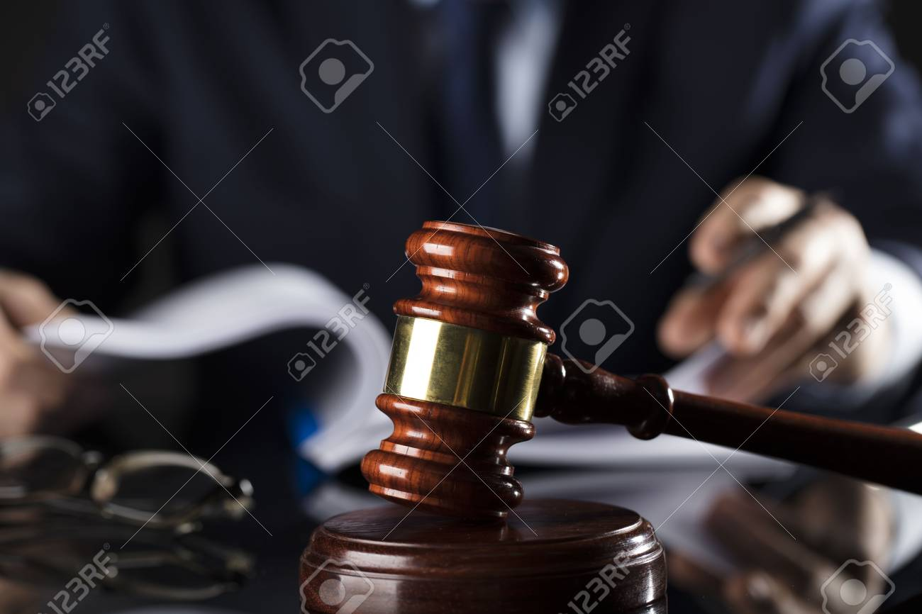 Judge signs the documents. Gavel. Law and justice theme. - 91897414