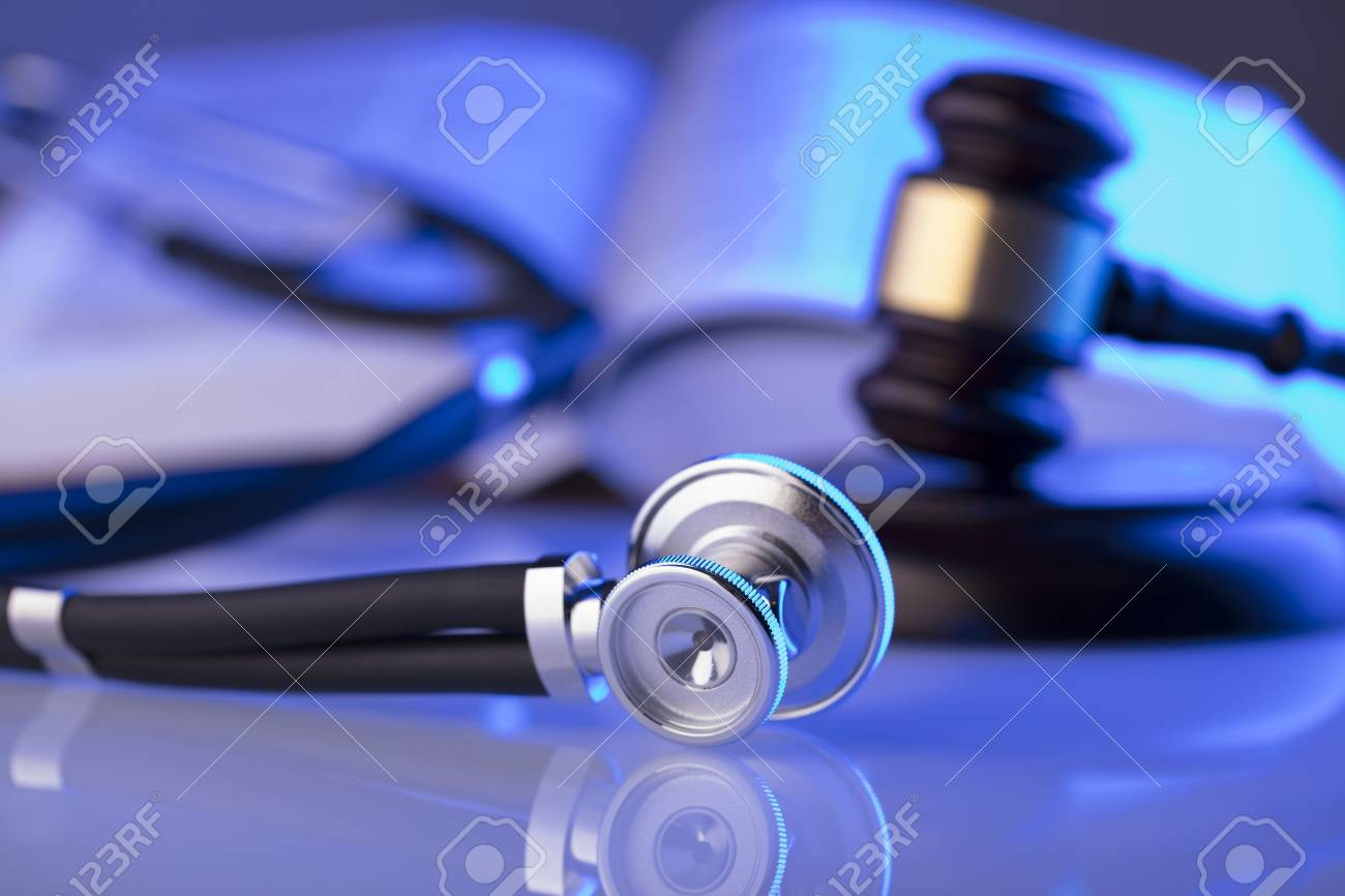 Medical law concept. Gavel, stethoscope, blue light. Place fort text. - 94917955