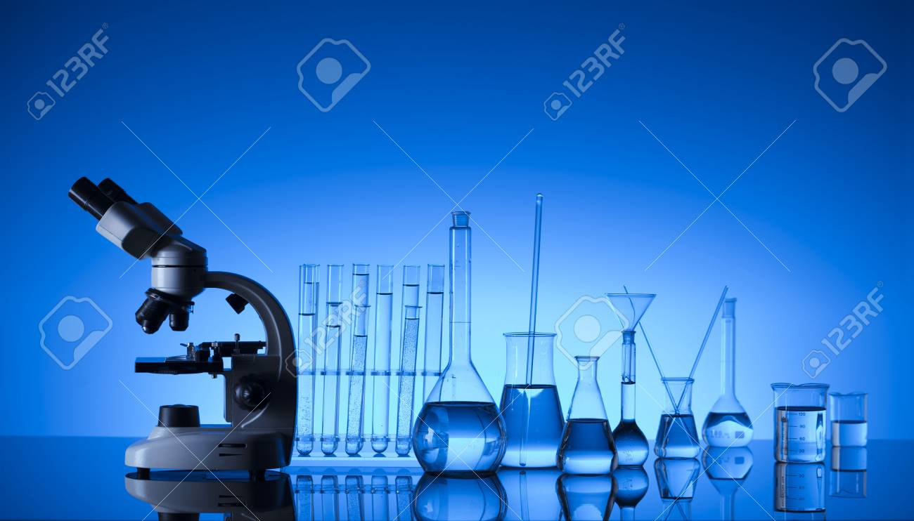 Laboratory concept. Science experiment. Laboratory glassware, microscope. Blue background. - 98175940