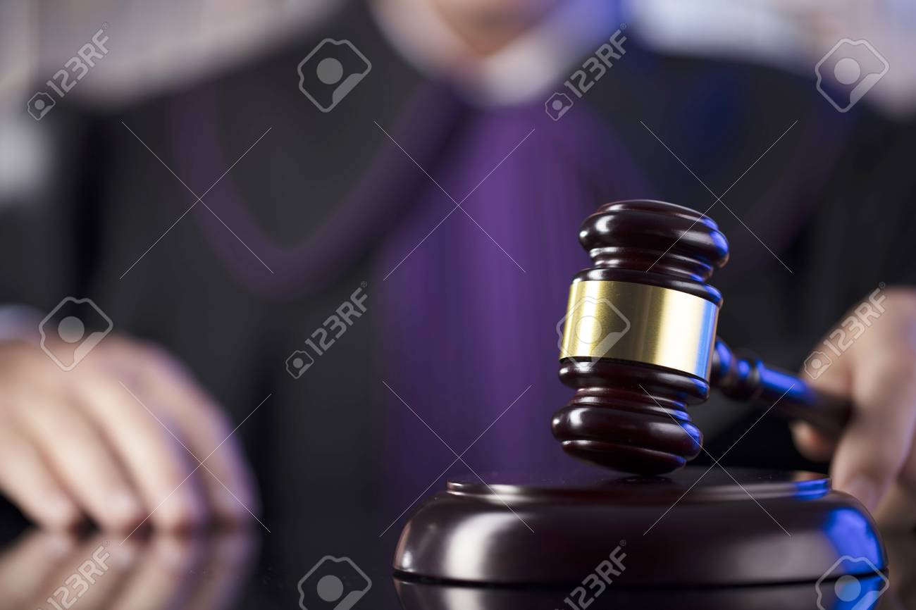 Judge in the courtroom. Male judge striking the gavel. - 108320214