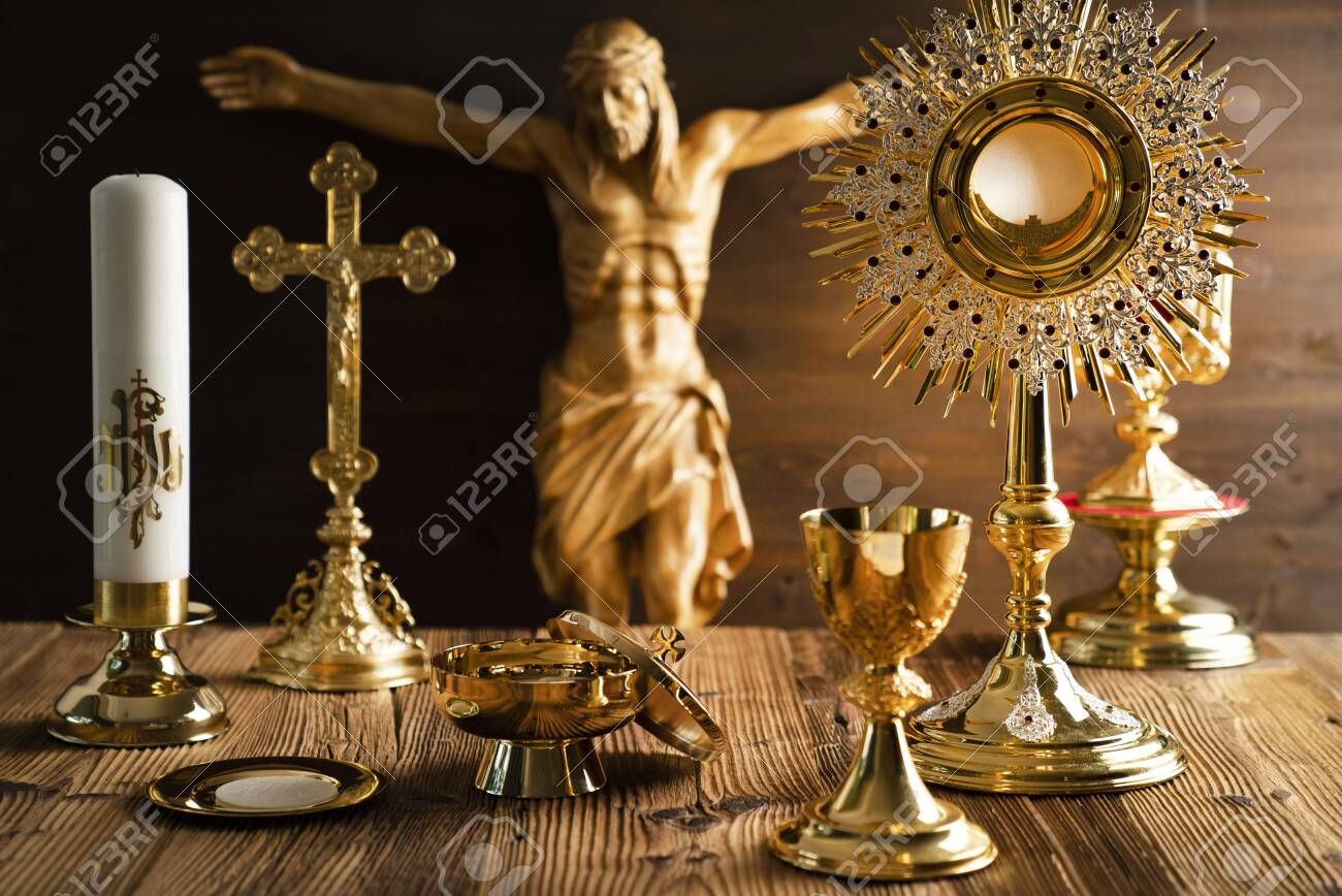 Catholic concept background. The Cross, Jesus figure, monstrance and golden chalice on the altar. - 129215161