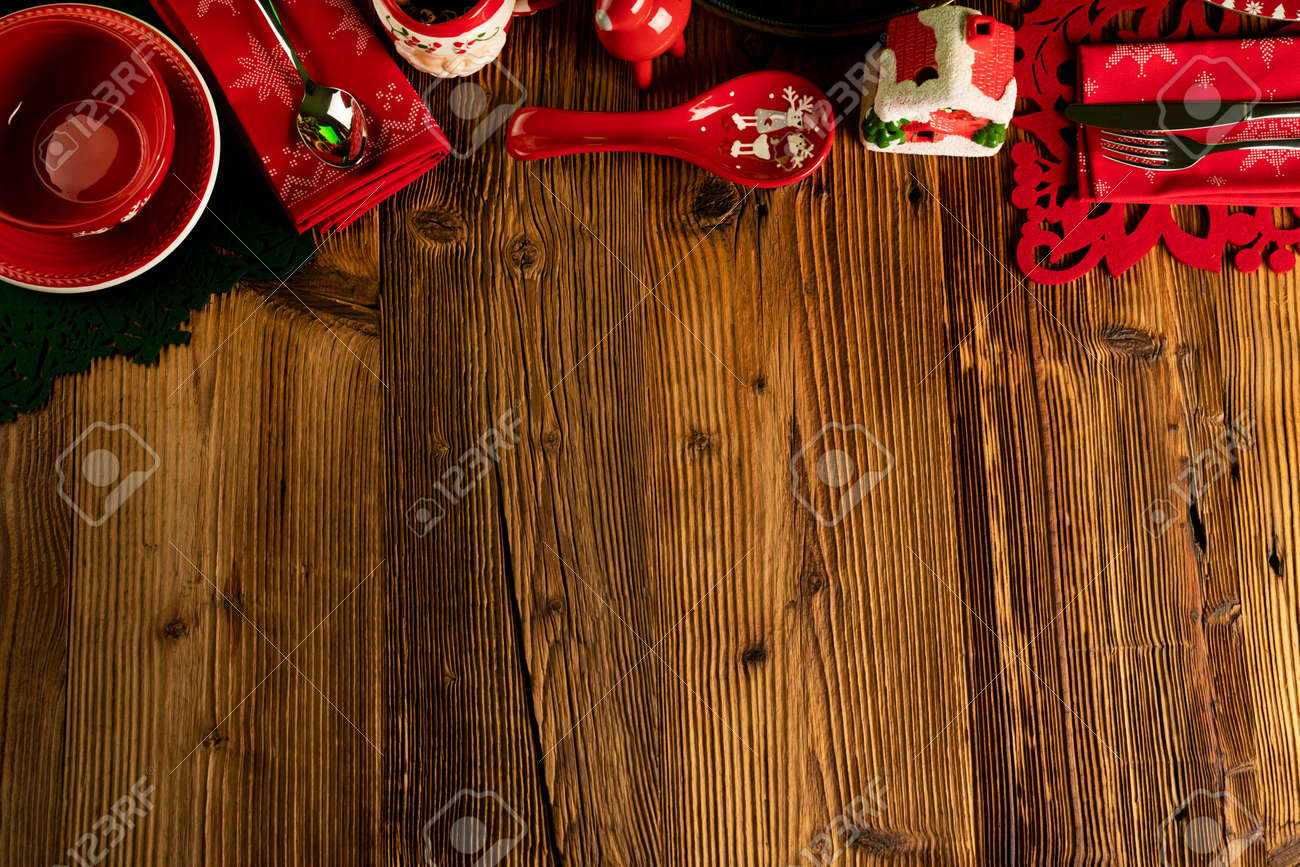 Christmas background. Christmas tableware and decorations on rustic wooden table. - 135402072