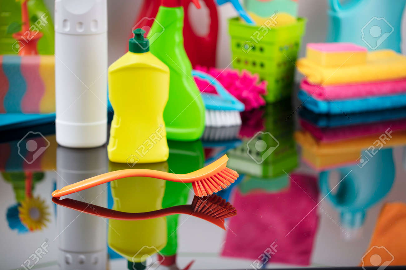 House and office cleaning theme. Colorful cleaning kit on glass table. - 156564801