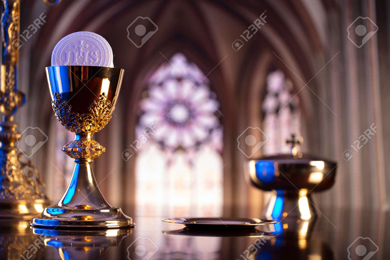 First Holy Communion. Catholic religion theme. Crucifix, the Croass and Golden chalice and wafer on the altar. - 168775424