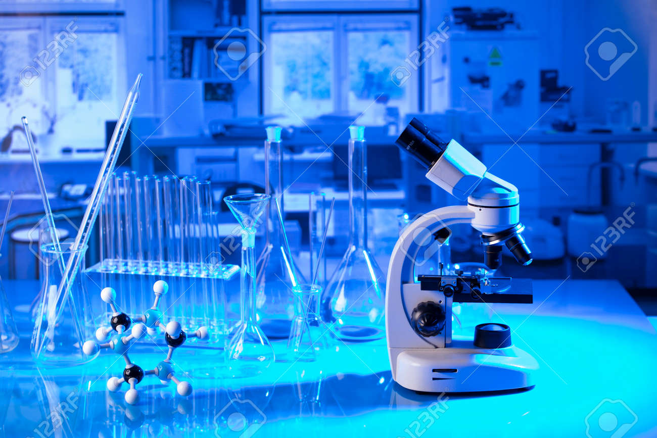 pandemic theme. Science research concerning fast tests and anti-vaccine. Microscope, beakers and test tubes in the scientific laboratory. - 169346737