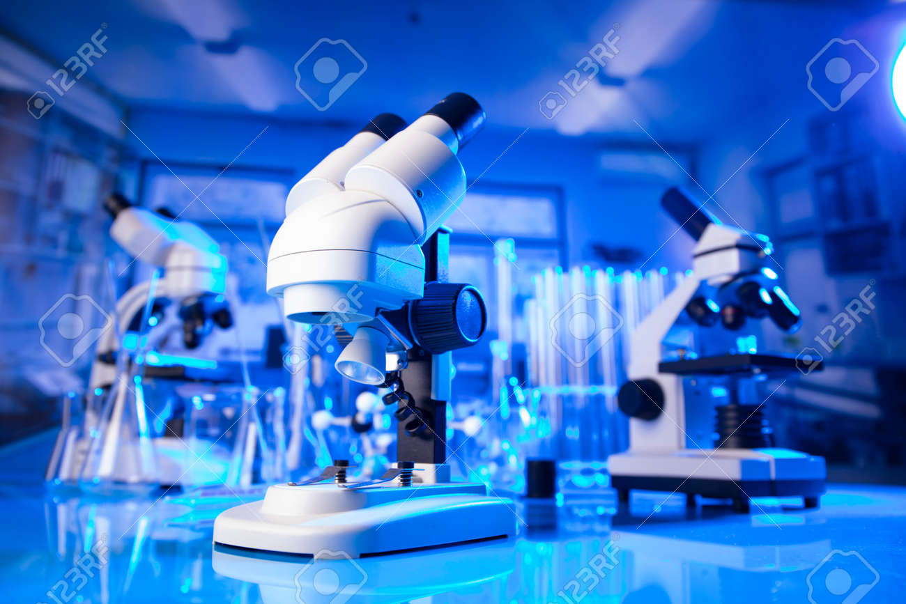 pandemic theme. Science research concerning fast tests and anti-vaccine. Microscope, beakers and test tubes in the scientific laboratory. - 169346777