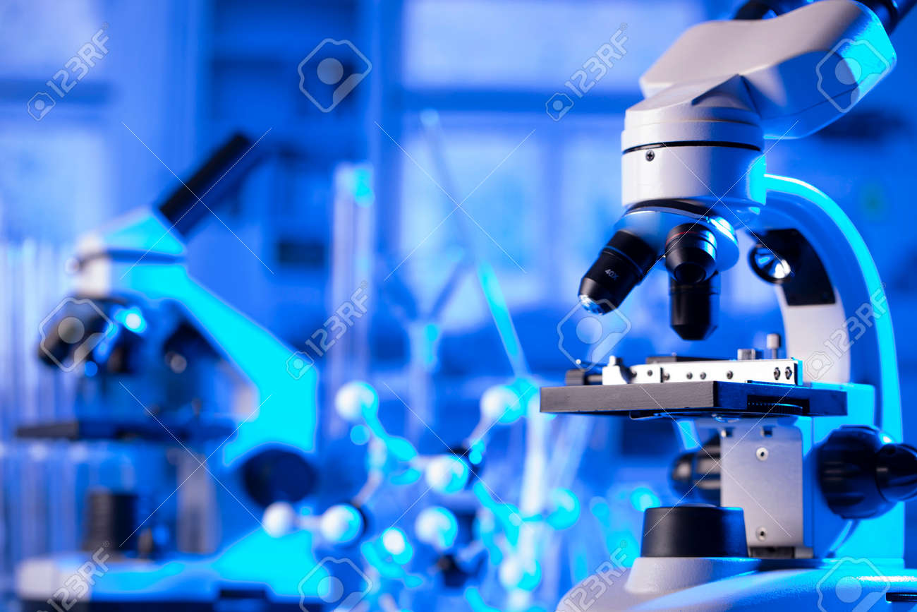 virus pandemic theme. Science research concerning fast tests and anti-vaccine. Microscope, beakers and test tubes in the scientific laboratory. - 169346786