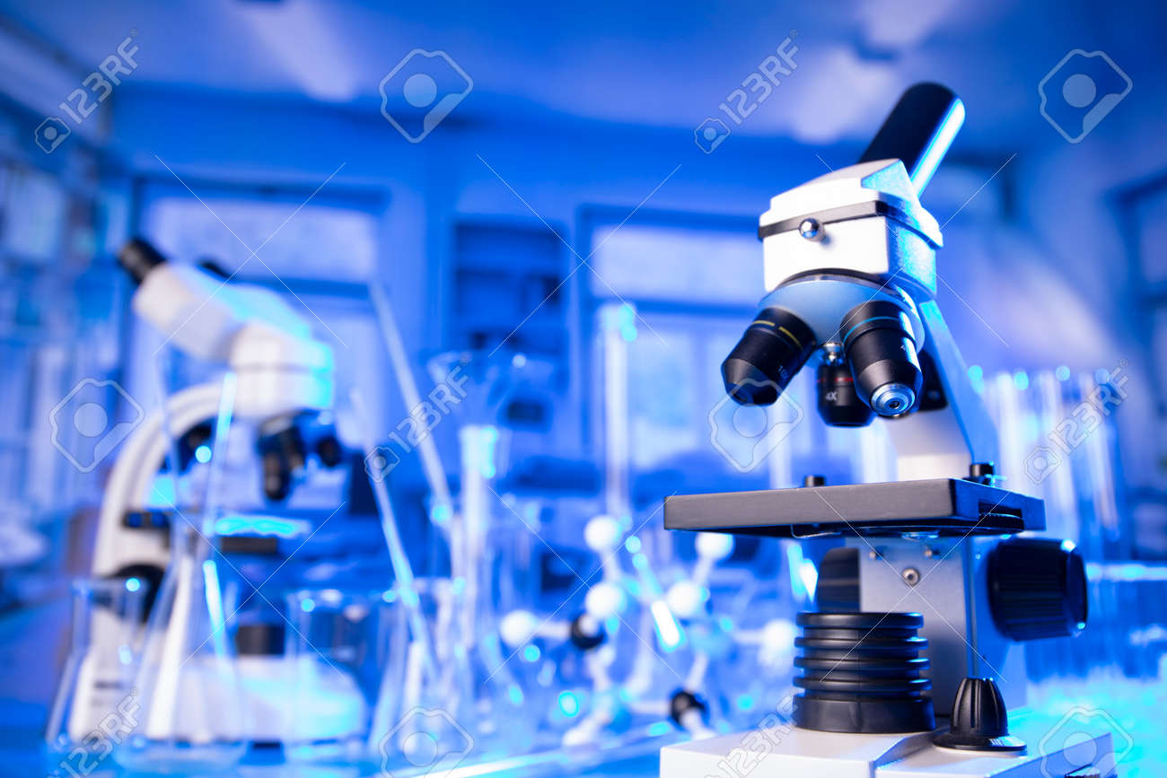 pandemic theme. Science research concerning fast tests and anti- vaccine. Microscope, beakers and test tubes in the scientific laboratory. - 169346854