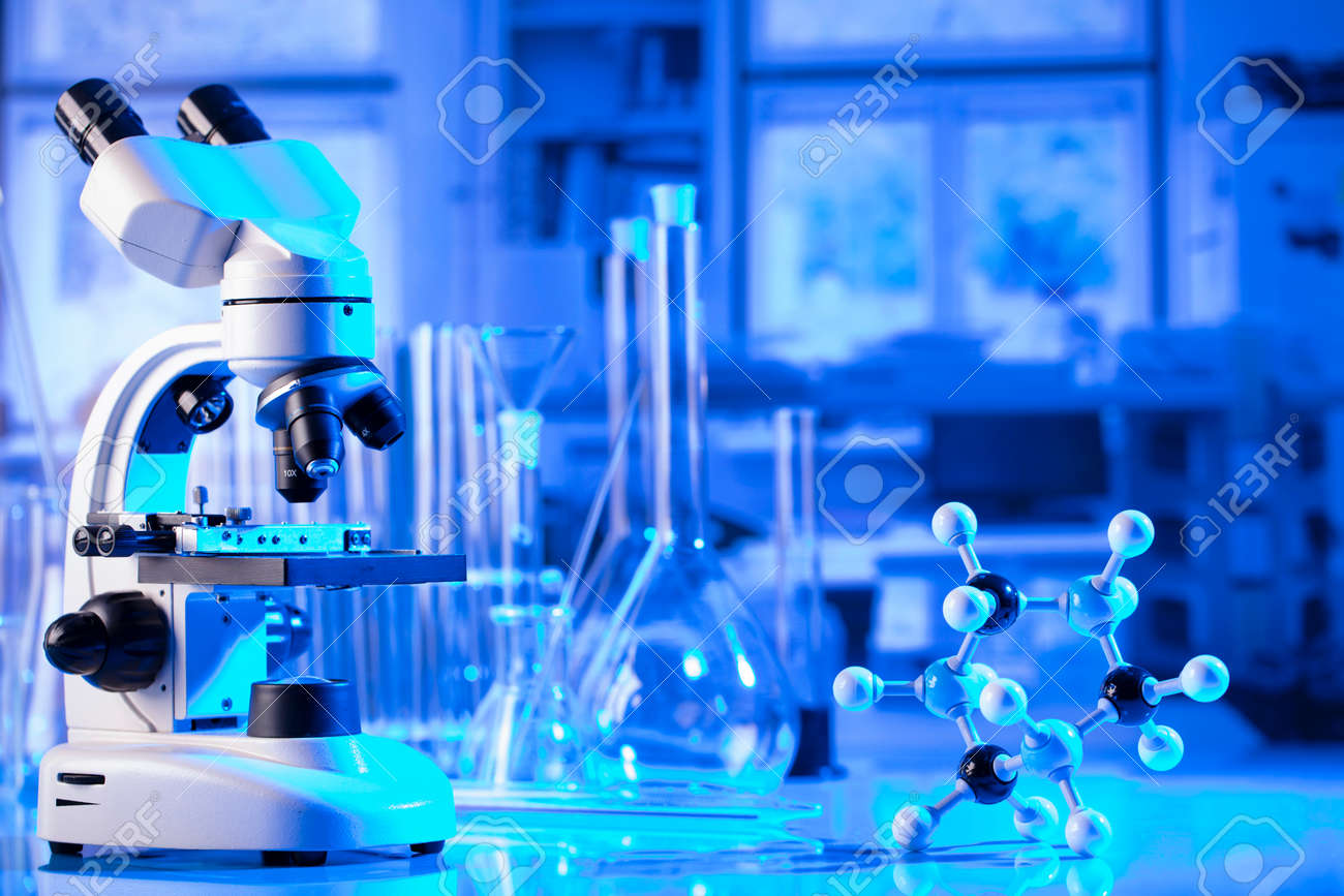 pandemic theme. Science research concerning fast tests and anti-vaccine. Microscope, beakers and test tubes in the scientific laboratory. - 169346855