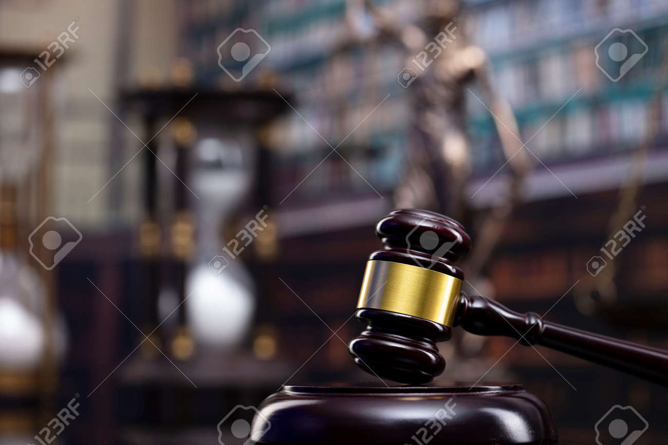 Law and justice concept. Gavel of the jugde, Themis sculpture and scale of justice in the court library. - 169346859
