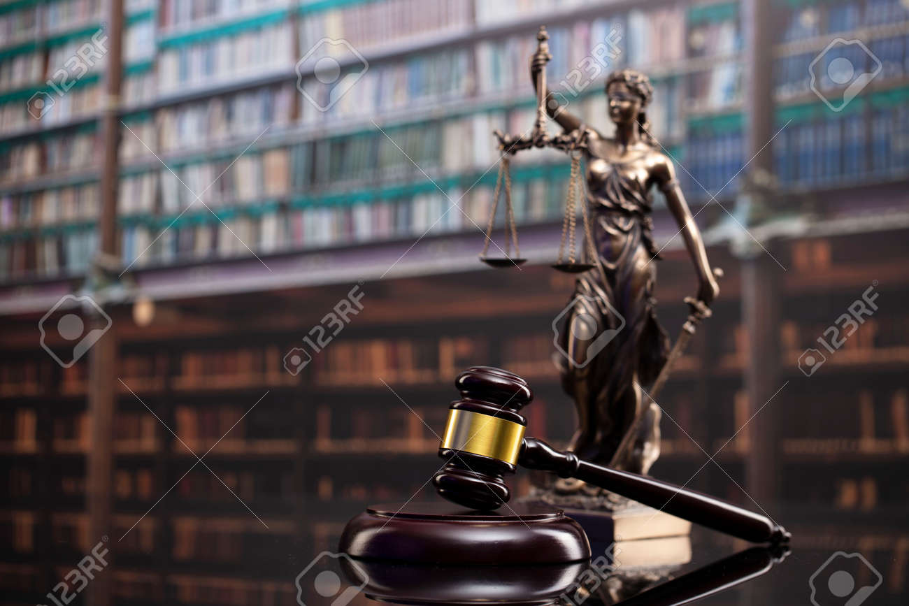 Law and justice concept. Gavel of the jugde, Themis sculpture and scale of justice in the court library. - 169346860