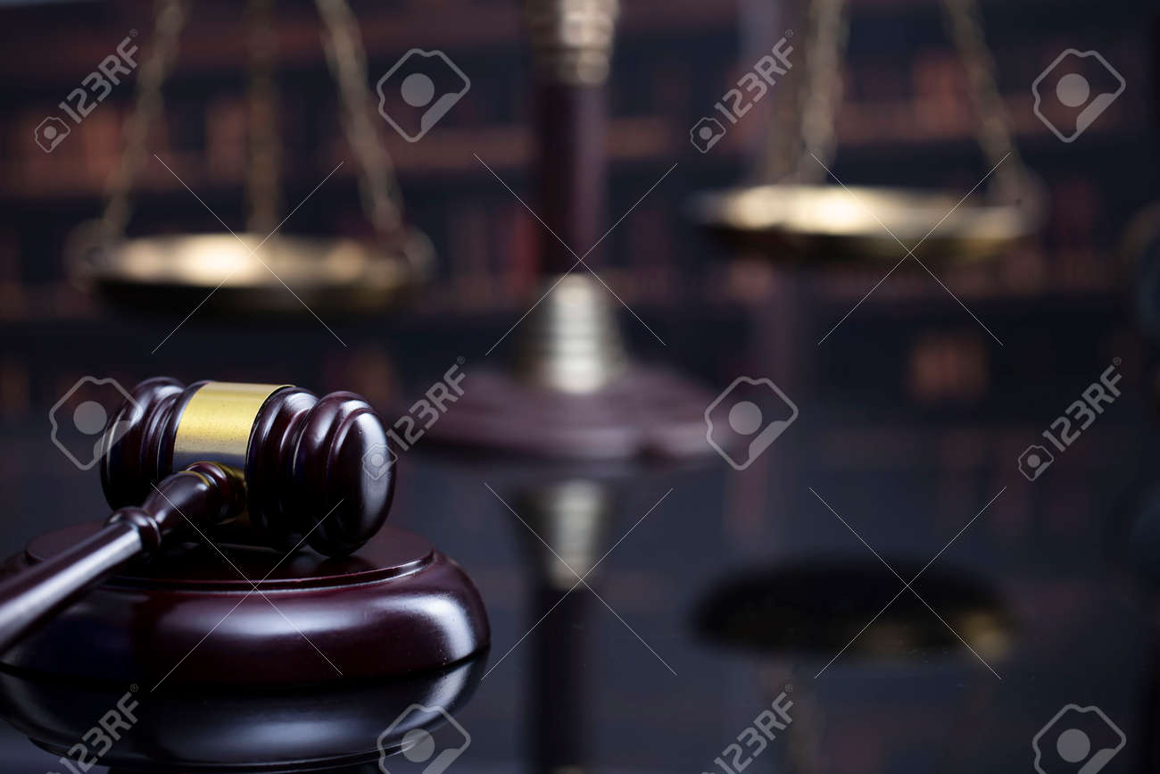 Law and justice concept. Gavel of the jugde, Themis sculpture and scale of justice in the court library. - 169346861