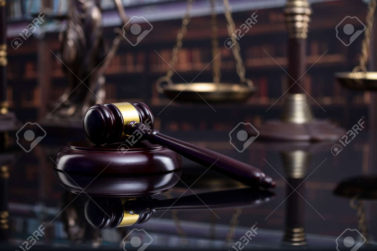 Law and justice concept. Gavel of the jugde, Themis sculpture and scale of justice in the court library. - 169346862
