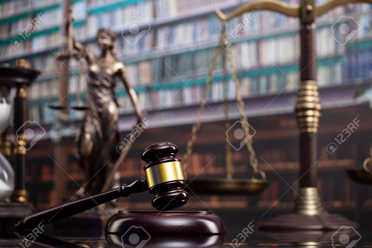 Law and justice concept. Gavel of the jugde, Themis sculpture and scale of justice in the court library. - 169346865