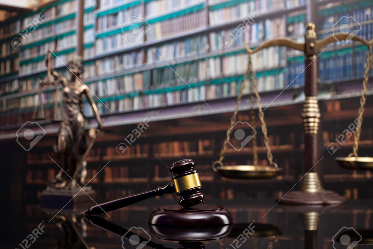 Law and justice concept. Gavel of the jugde, Themis sculpture and scale of justice in the court library. - 169346866