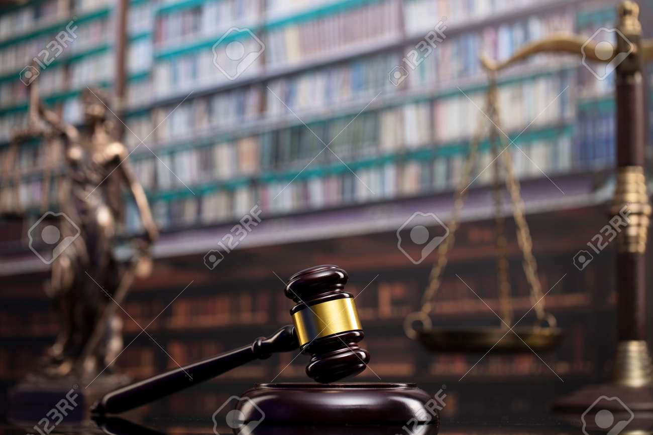 Law and justice concept. Gavel of the jugde, Themis sculpture and scale of justice in the court library. - 169346867