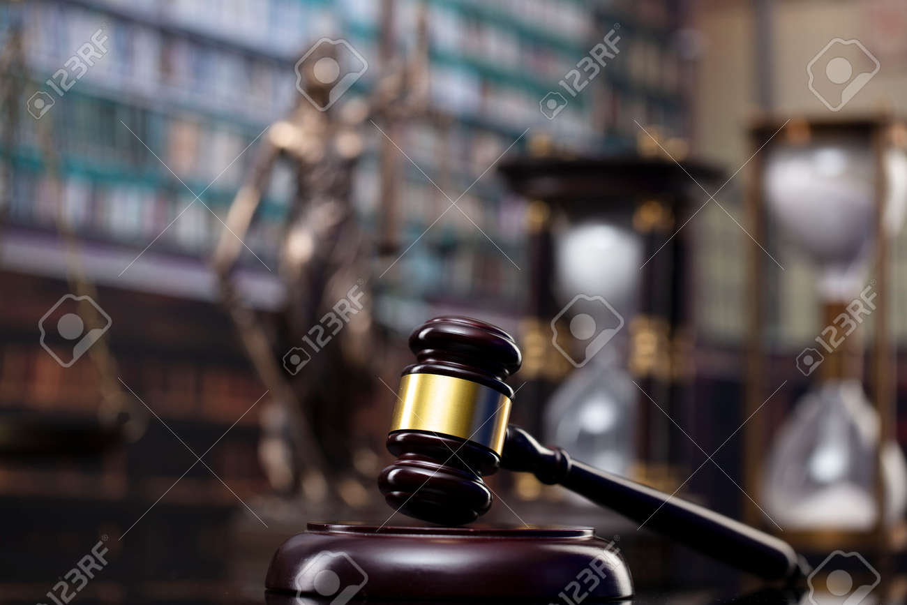 Law and justice concept. Gavel of the jugde, Themis sculpture and scale of justice in the court library. - 169346868