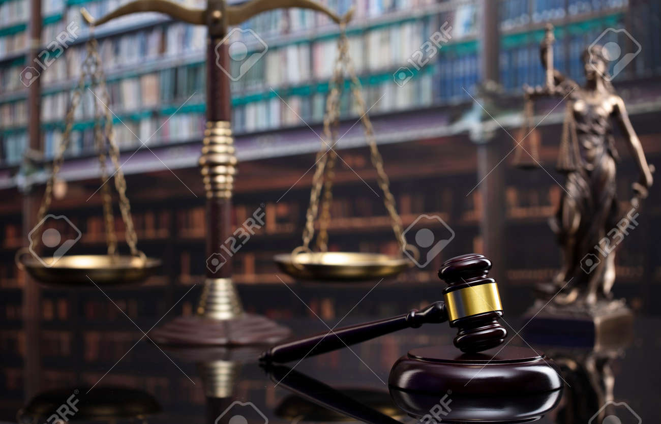 Law and justice concept. Gavel of the jugde, Themis sculpture and scale of justice in the court library. - 169346871