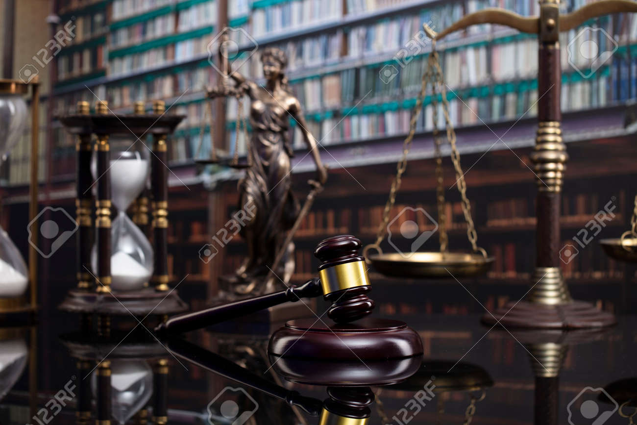 Law and justice concept. Gavel of the jugde, Themis sculpture and scale of justice in the court library. - 169346872