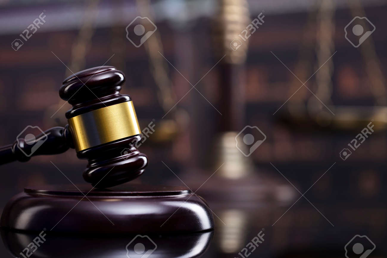 Law and justice concept. Gavel of the jugde, Themis sculpture and scale of justice in the court library. - 169346885
