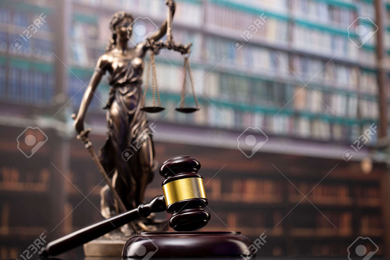 Law and justice concept. Gavel of the jugde, Themis sculpture and scale of justice in the court library. - 169346887