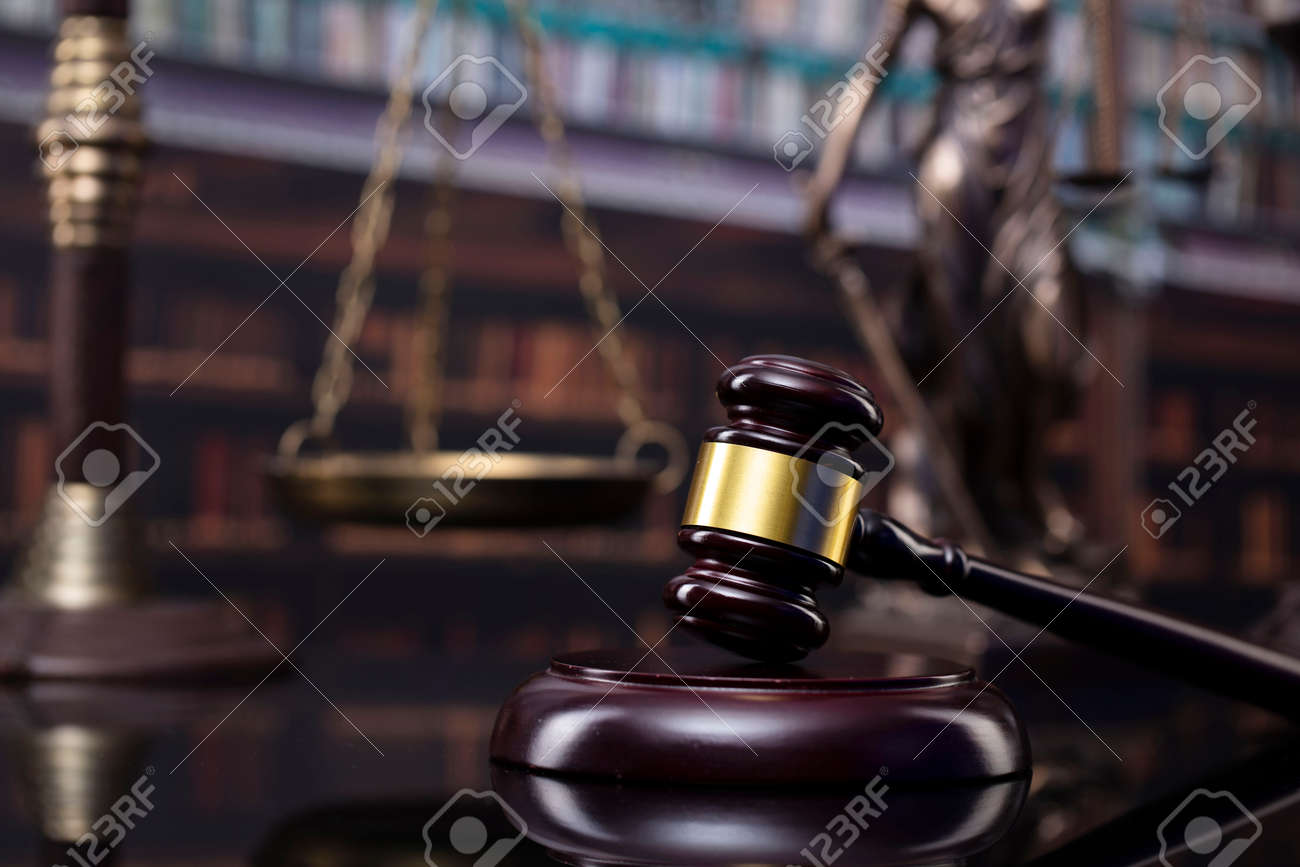 Law and justice concept. Gavel of the jugde, Themis sculpture and scale of justice in the court library. - 169346892