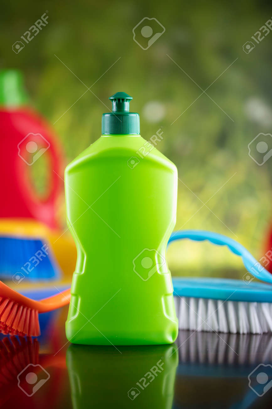 Spring house and office cleaning. Cleaning kit and sources on the glass table. Bokeh background. - 169346953