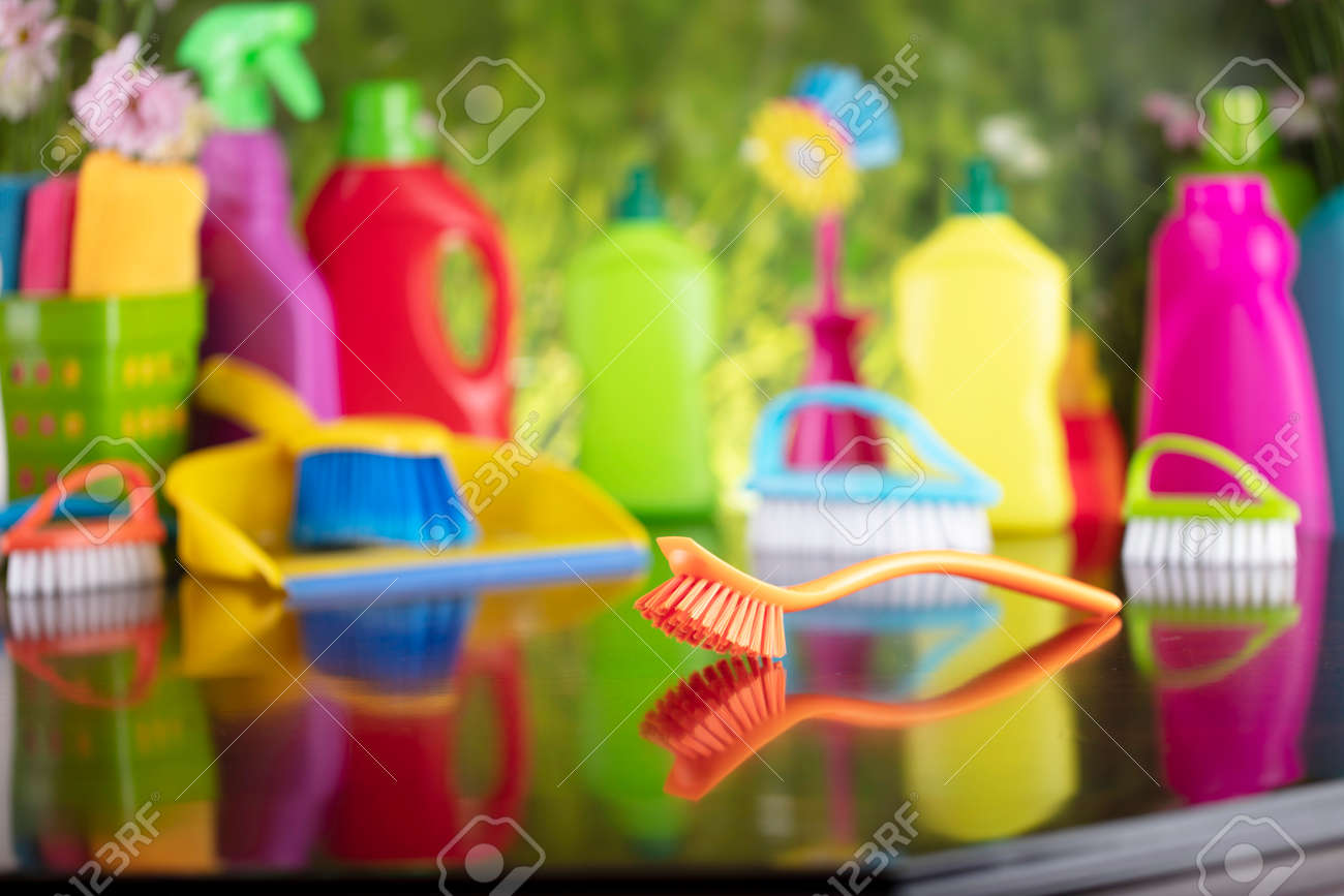 Spring house and office cleaning. Cleaning kit and sources on the glass table. Bokeh background. - 169346957