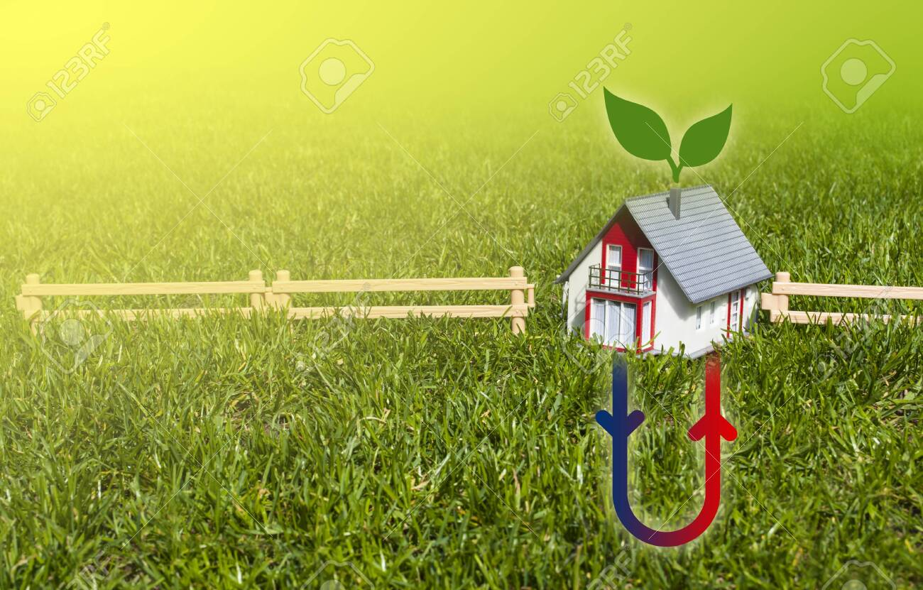 House with hermal heating system on meadow field - 131097993
