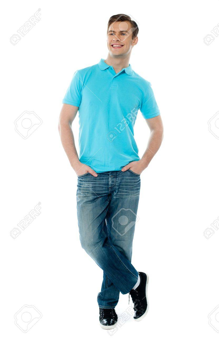 Full-body pose of smiling man posing in casuals with crossed legs Stock Photo - 13217229