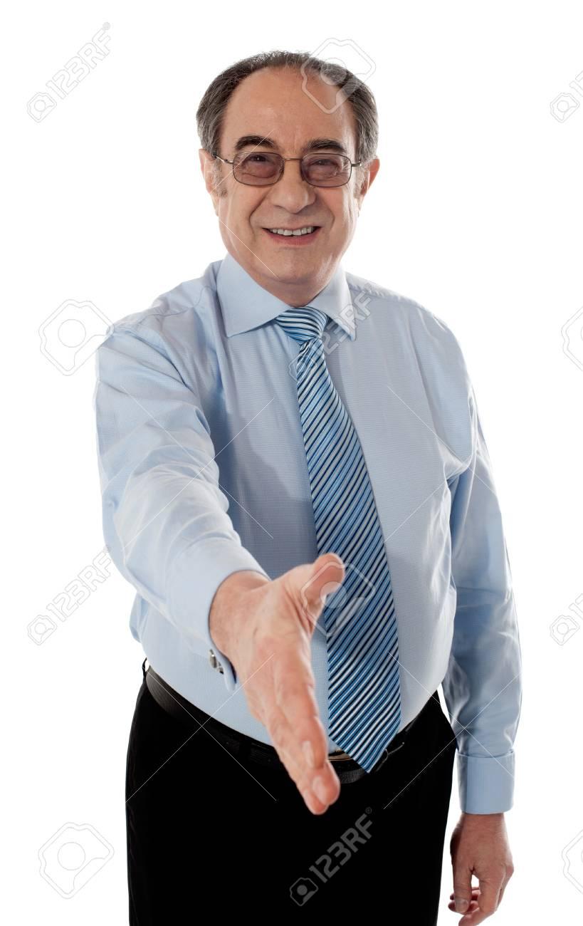 Businessman offering handshake to you, studio shot Stock Photo - 13217298