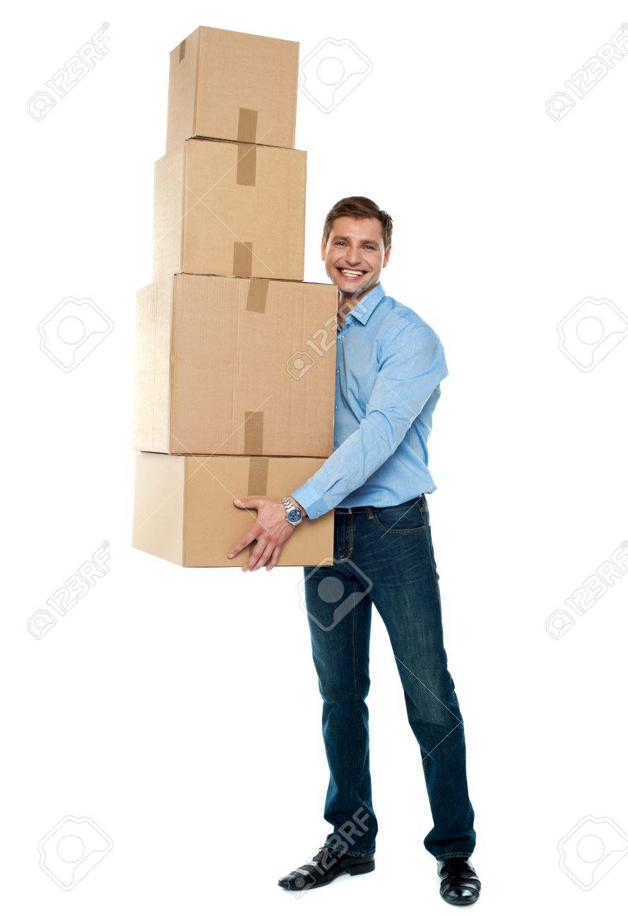 Confident young man with stack of cardboard boxes isolated against white background Stock Photo - 14087768