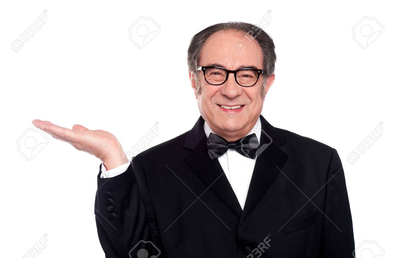 Man in party wear presenting copyspace. Smiling at camera Stock Photo - 14301731