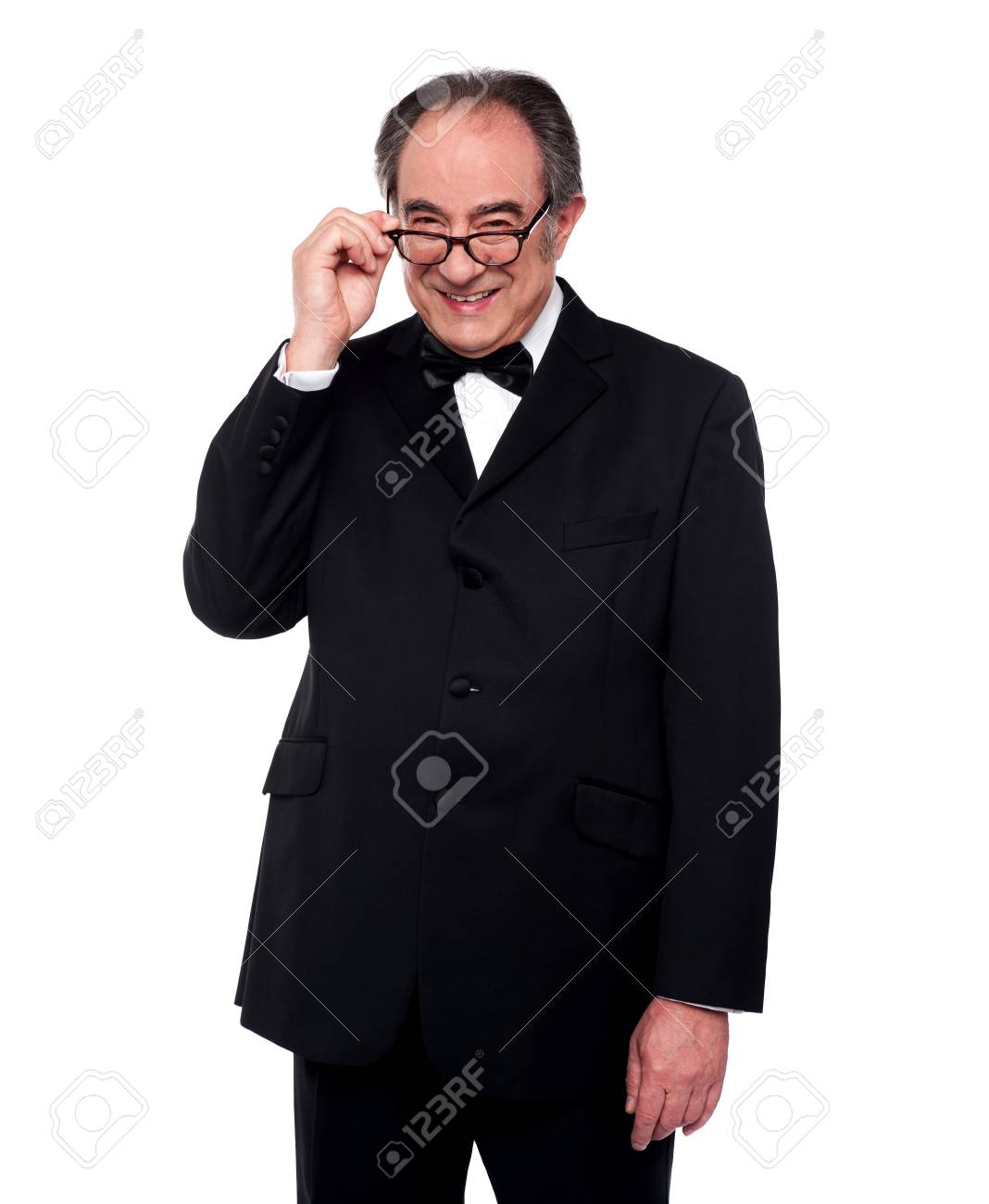 Old man holding his eyeglasses and smiling at camera. Fashion portrait Stock Photo - 14301728