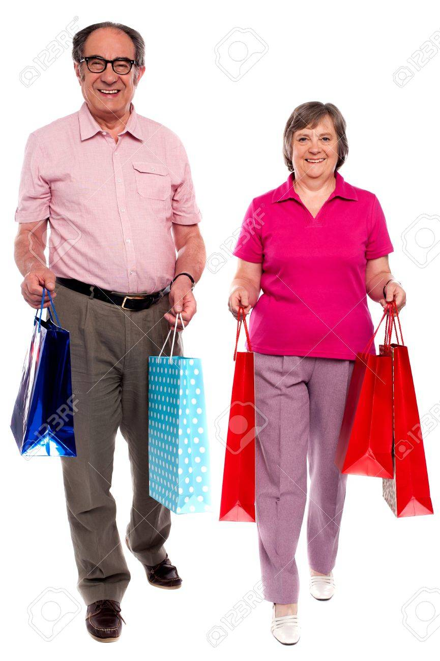 Husband and wife holding shopping bags and walking towards camera Stock Photo - 14301736