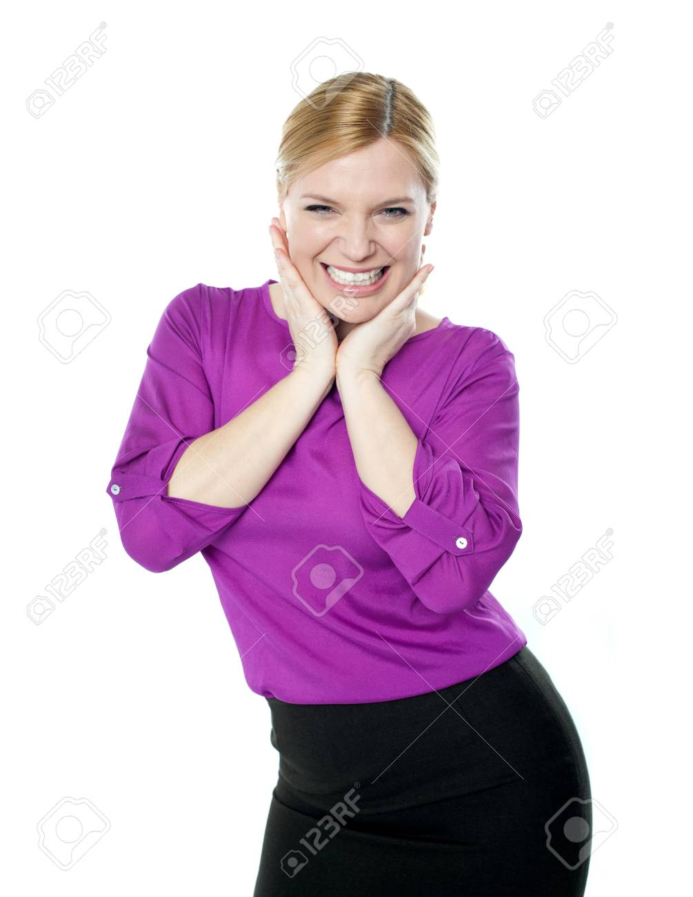 Excited woman posing with hands on chin isolated over white background Stock Photo - 14382673