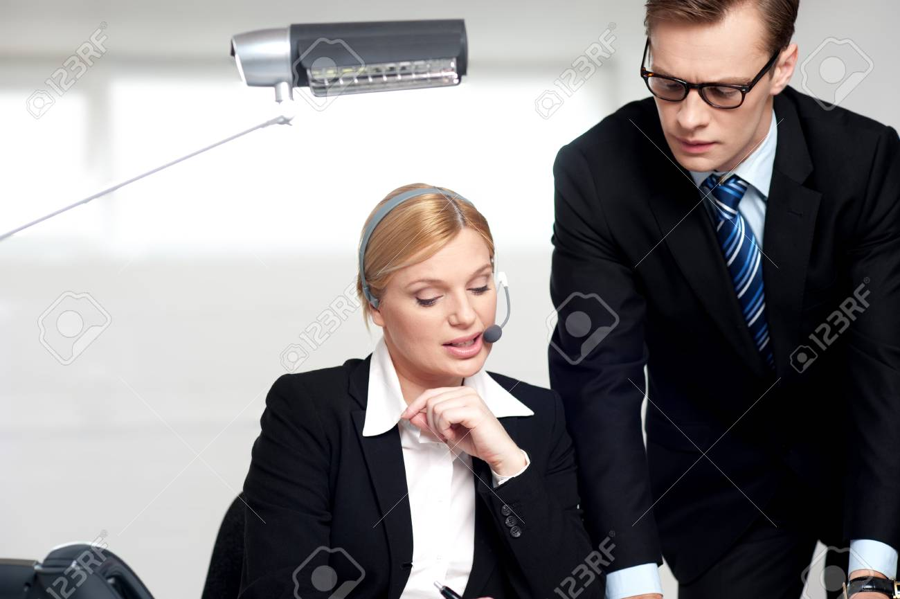 Female secretary explaining to boss in  the office Stock Photo - 14396846