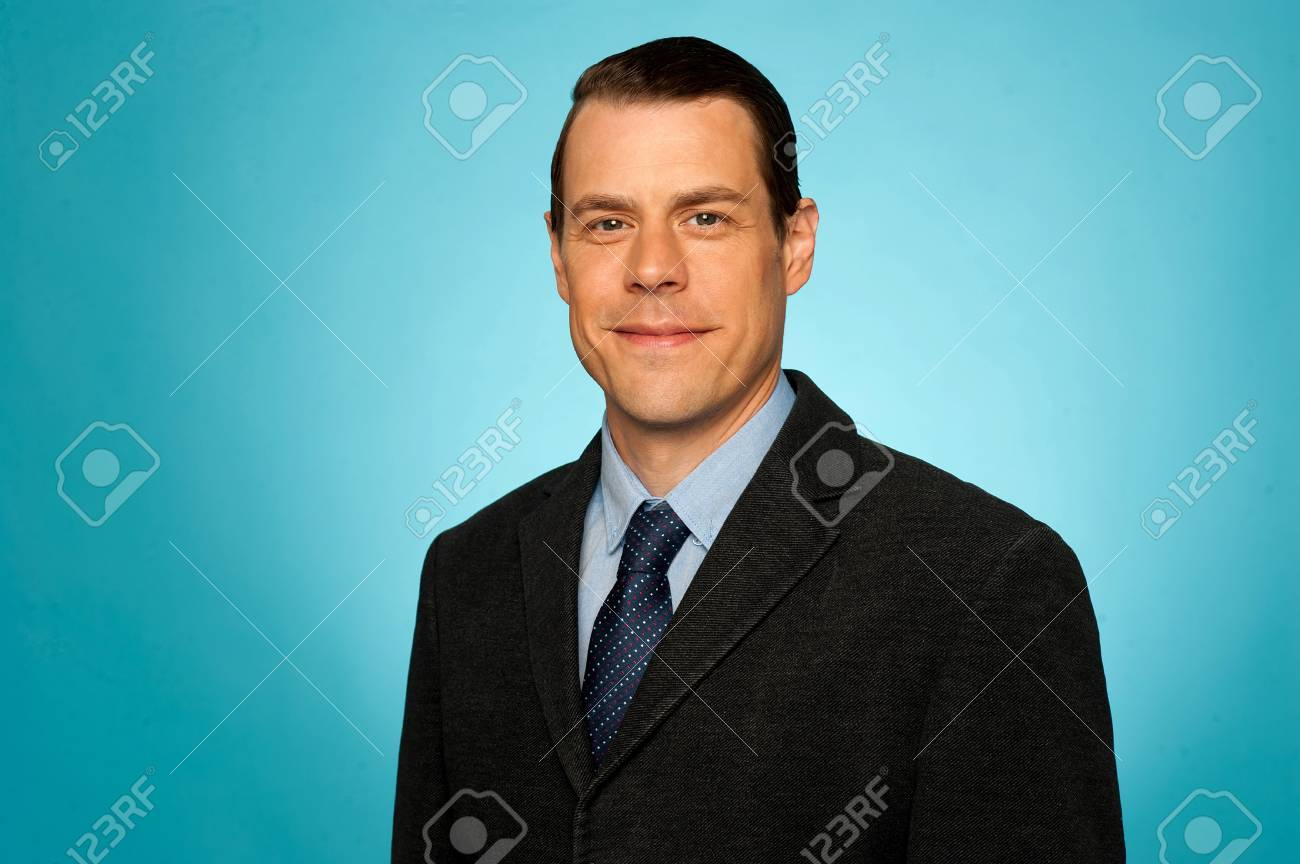 Portrait of smiling young businessman isolated over gradient background Stock Photo - 14603406