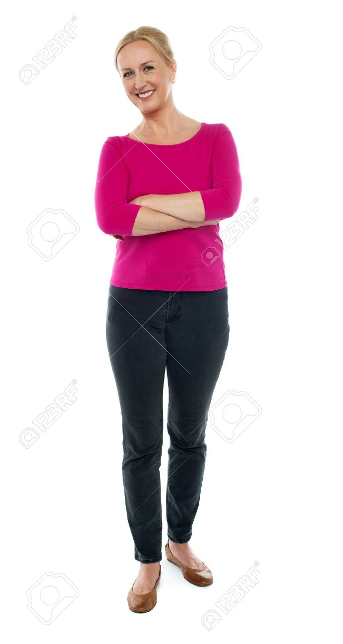 Full length portrait of happy aged woman posing with arms crossed isolated on white background Stock Photo - 14724379
